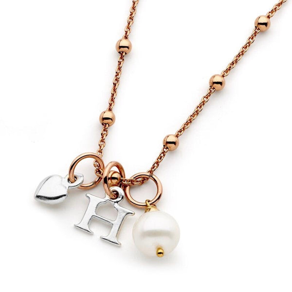 Image of Leoni & Vonk rose gold personalised necklace with pearl and heart drops photographed against a white background