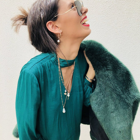 Model wearing Leoni & Vonk layered necklaces