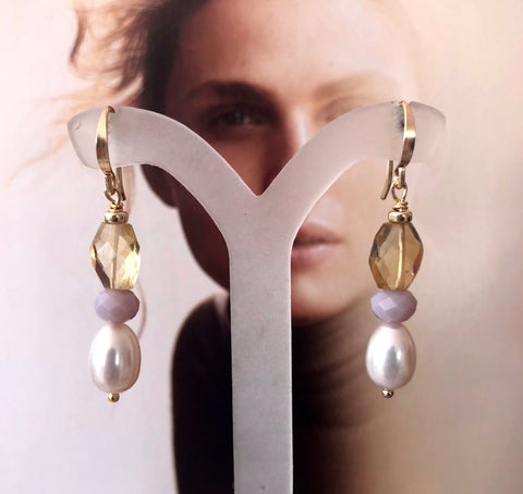 Leoni & Vonk citrine and pearl Roma earrings photographed on a magazine page