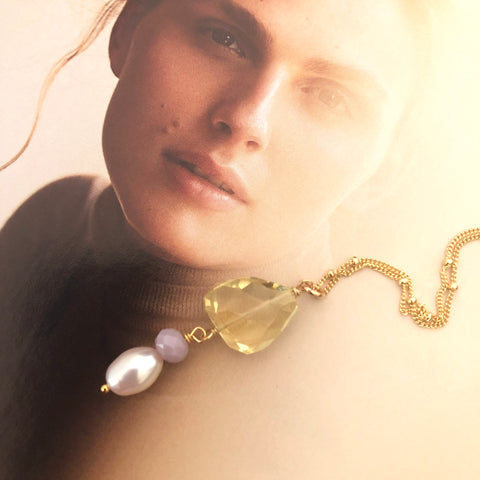 Image of Leoni & Vonk citrine and pearl Roma Necklace photographed on a magazine page