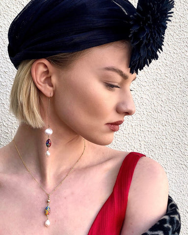 Image of model wearing Leoni & Vonk Venetian bead and pearl jewellery and a Murley & Co hat