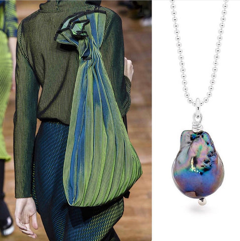 Leoni & Vonk peacock baroque pearl with green Issey Miyake outfit