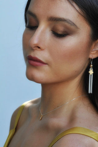 Model wearing Leoni & Vonk cross jewellery