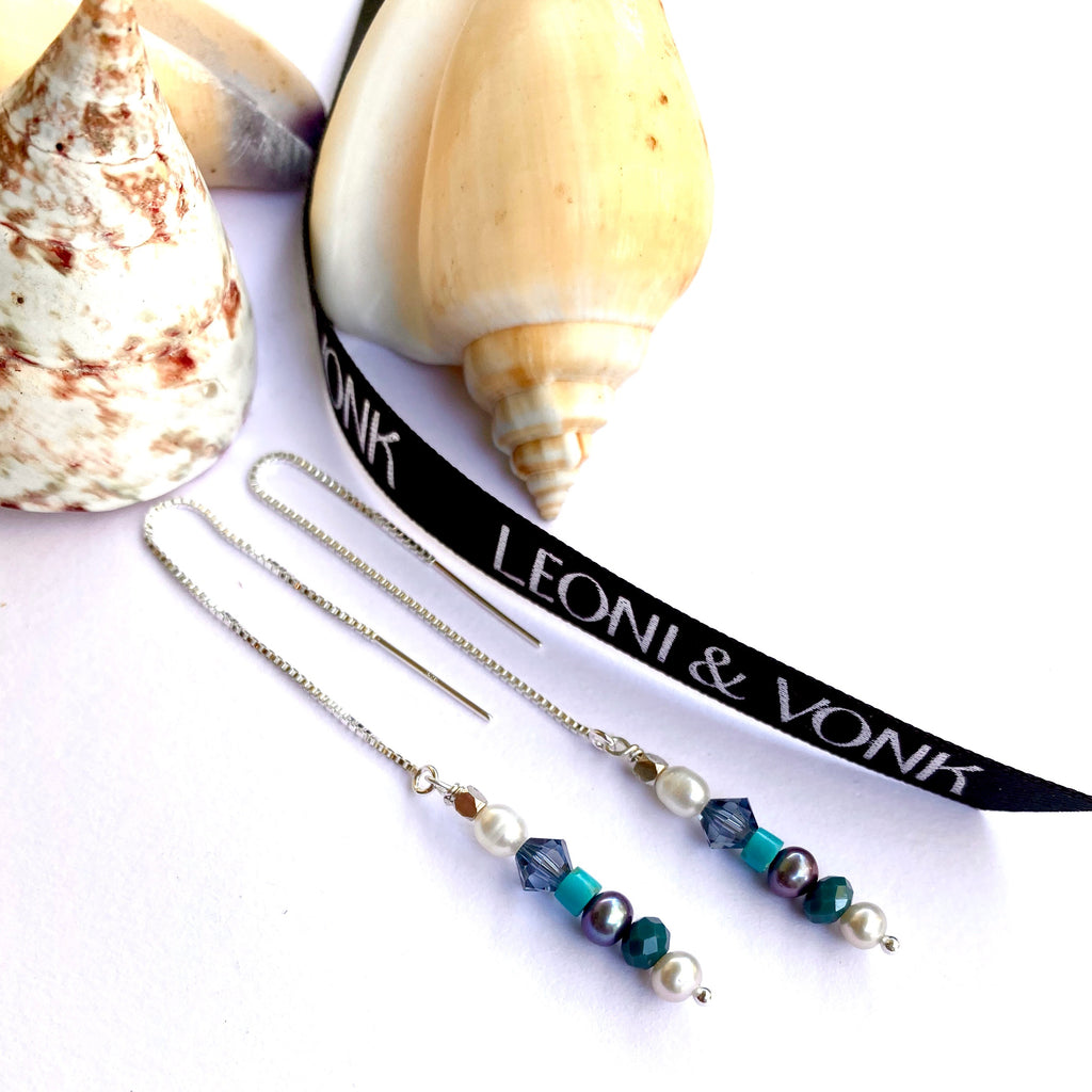 Leoni & Vonk crystal and pearl sterling silver chain earrings photographed near sea shells