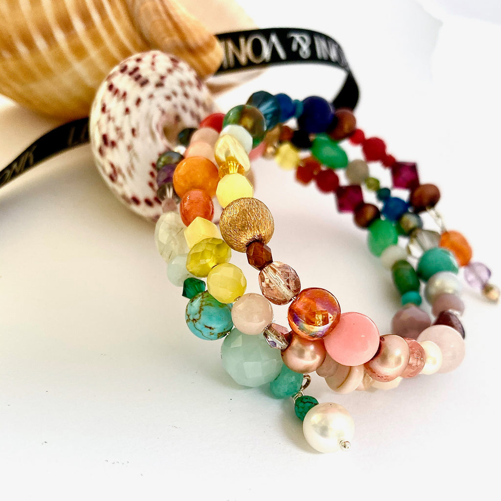 Leoni & Vonk bright coloured semi precious stone and pearl bracelet photographed near sea shells