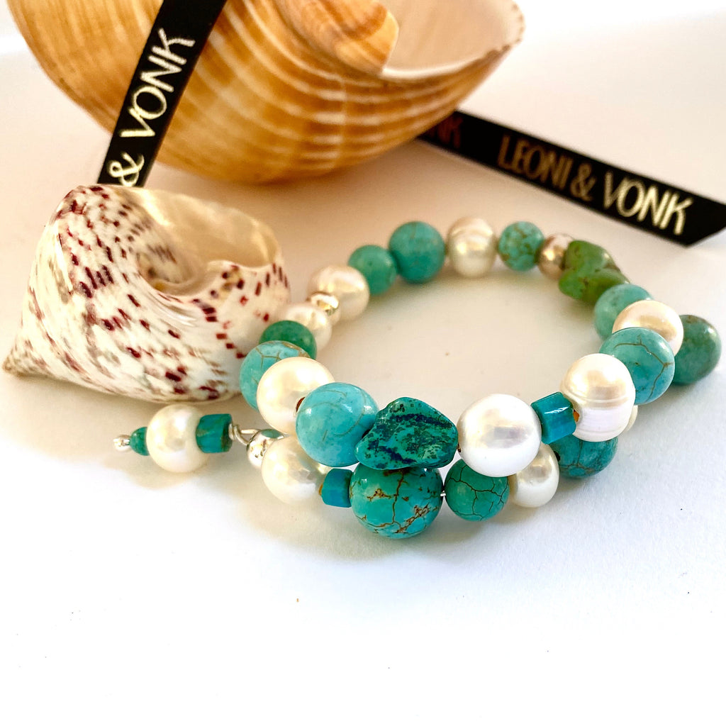 Leoni & Vonk turquoise and pearl stacking bracelet photographed near sea shells
