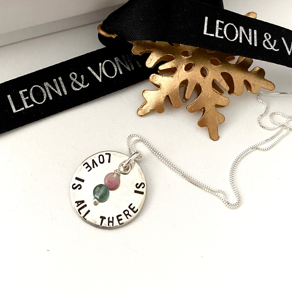 Leoni & Vonk silver Love Is All there is and tourmaline neckalce with a Christmas decoration and Leoni & Vonk ribbon