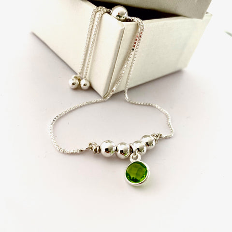 Leoni & Vonk sterling silver and peridot friendship bracelet  on a white box