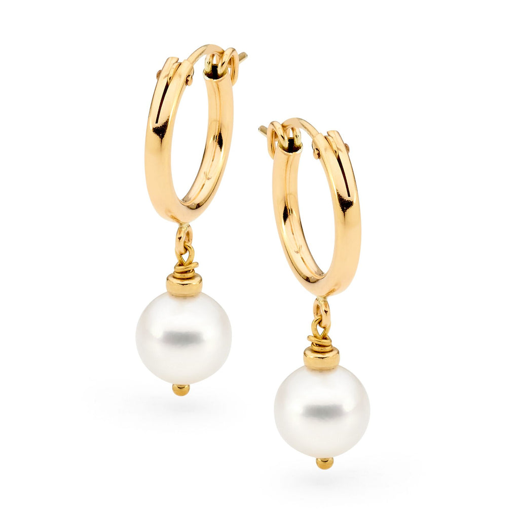 Leoni & Vonk gold hoop and white pearl earrings photographed against a white background