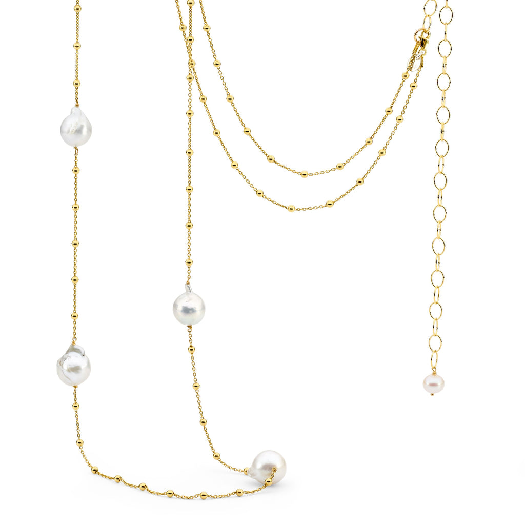 Leoni & Vonk white baroque pearl and gold chain necklace photographed against a white background