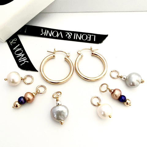 Leoni & Vonk interchangeable gold hoop earrings photographed near Leoni & Vonk ribbon