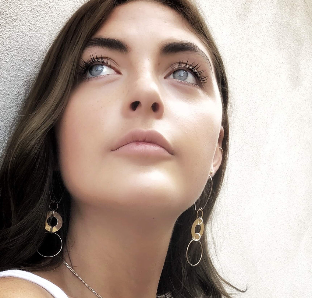 Model wearing Leoni & Vonk gold fill circle statement earrings