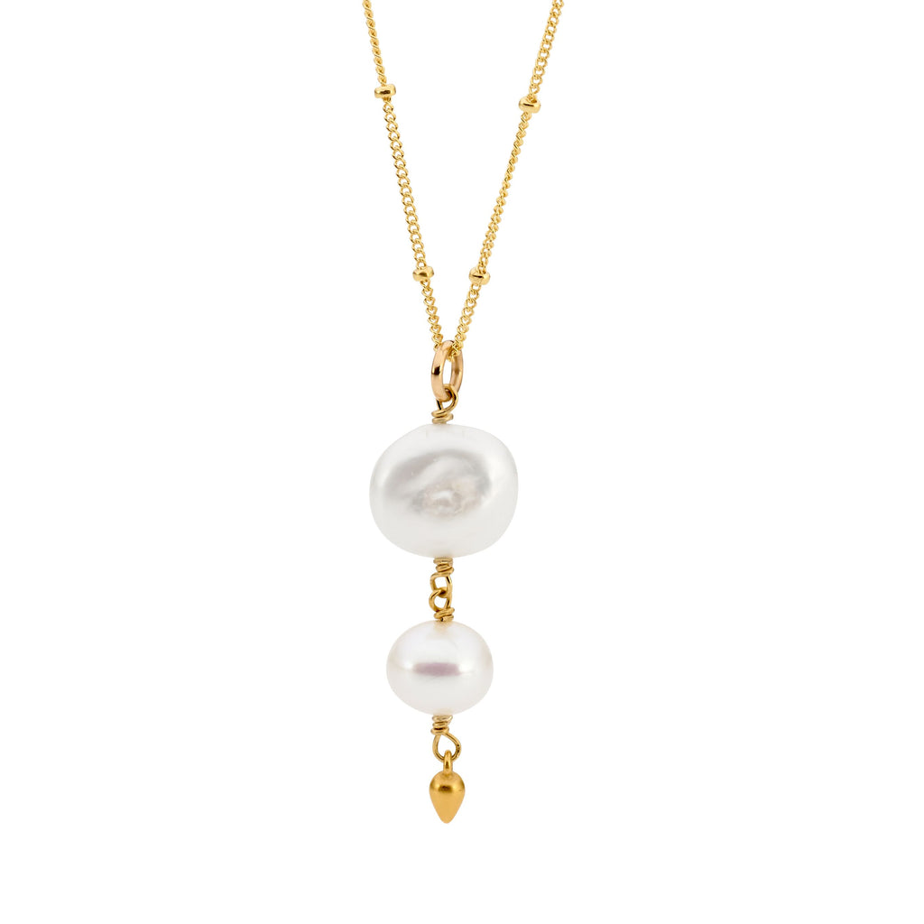 Leoni & Vonk white keshi pearl and gold drop necklace photographed on a white background