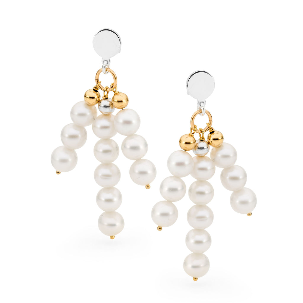 Leoni & Vonk white pearl statement earrings photographed against a white background
