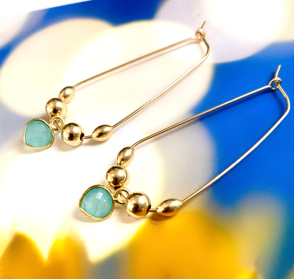 Leoni & Vonk peruvian chalcedony heart gold hoop earrings on a blue and yellow background