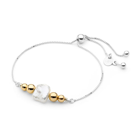 Leoni & Vonk white pearl and gold fill friendship bracelet photographed against  a white background