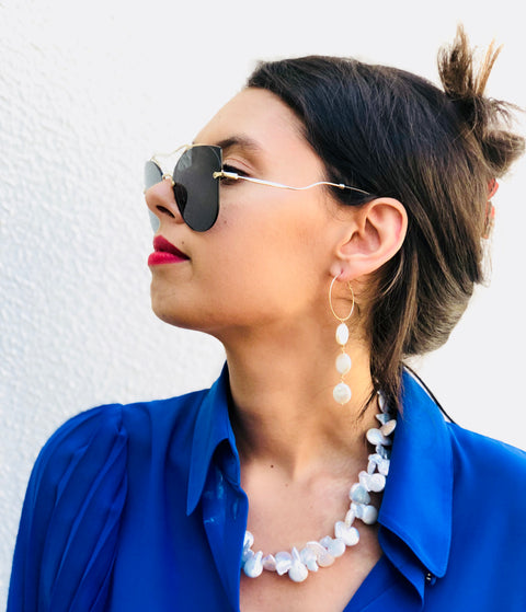 Model wearing Leoni & Vonk keshi pearl necklace, earrings and Country Road royal blue shirt and Miu Miu sunglasses