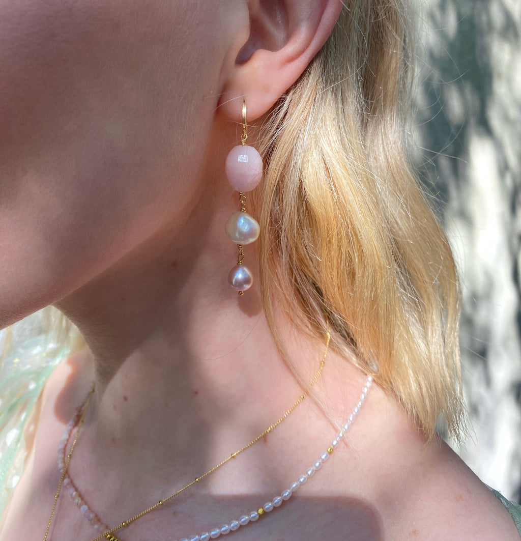 Leoni & Vonk pink peruvian opal adn pearl earrings worn by a model with blonde hair
