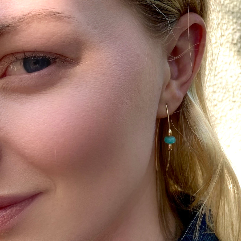 Blonde model wearing amazonite and gold fill earrings