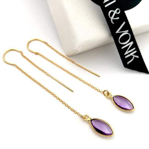 Leoni & Vonk amethyst and gold chain hook earrings photographed near a white box and Leoni & Vonk ribbon
