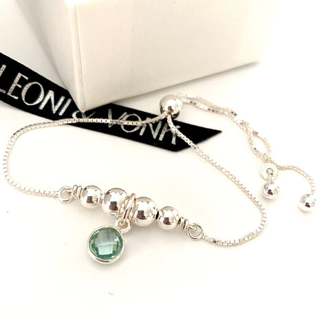 Leoni & Vonk aquamarine sterling silver bracelet photographed near a white box and Leoni & Vonk ribbon