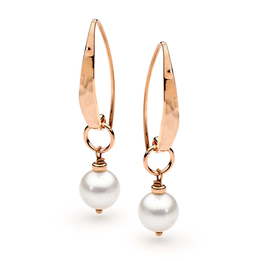 Image of Leoni & Vonk rose gold and pearl earrings photographed against a white background.