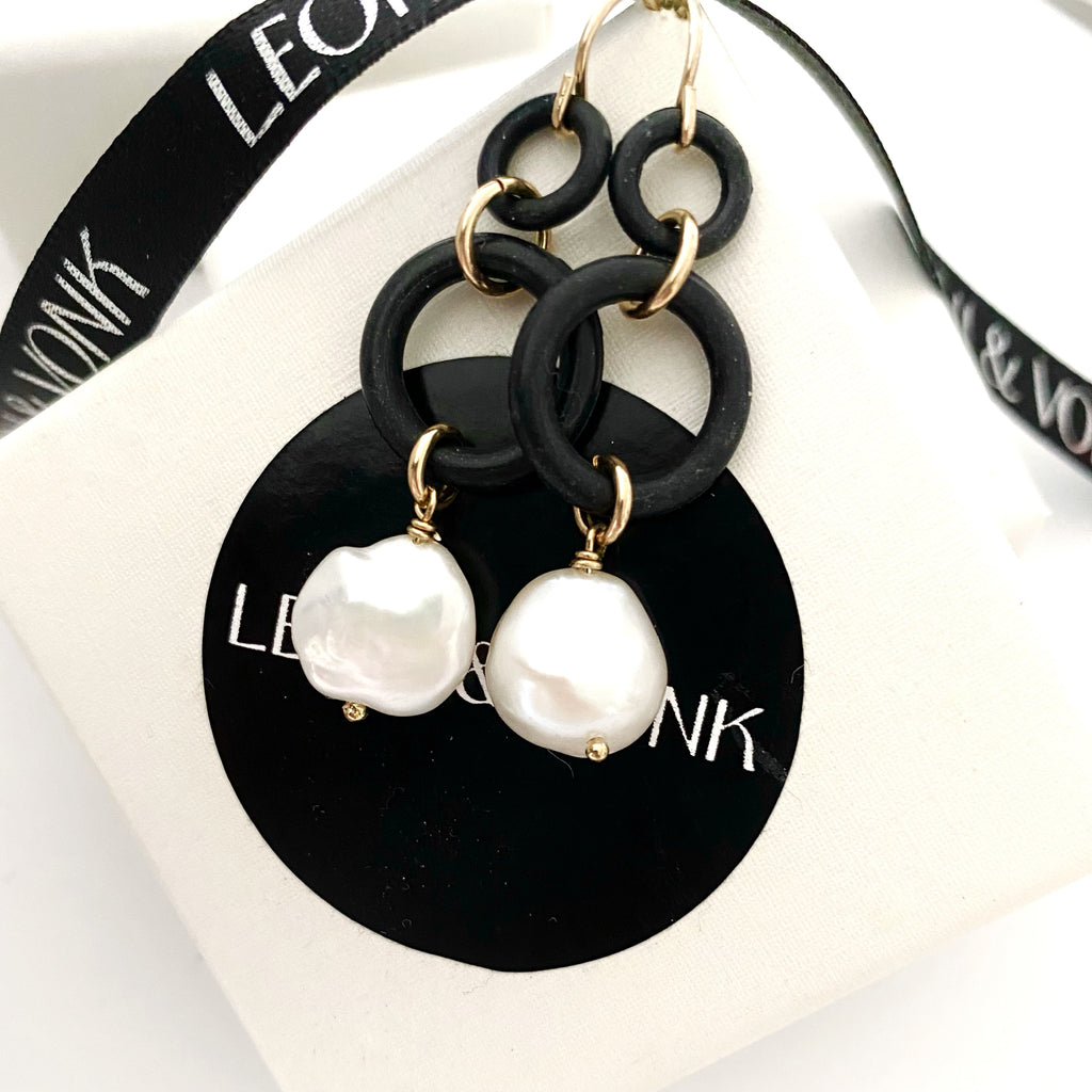 Leoni & Vonk rubber, gold fill and pearl earrings photographed near Leoni & Vonk ribbon