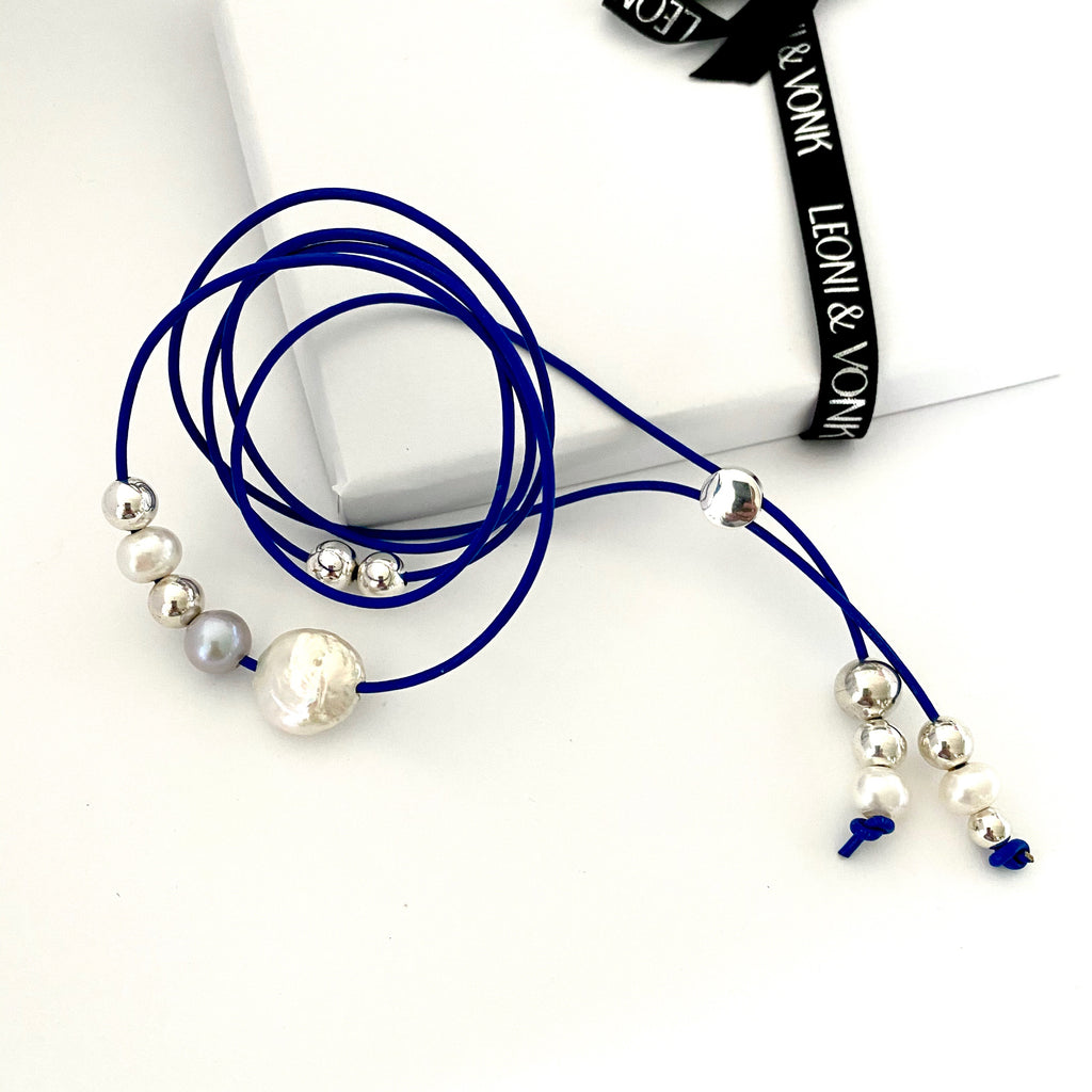 Leoni & Vonk blue cobalt leather and pearl necklace photographed with Leoni & Vonk  ribbon