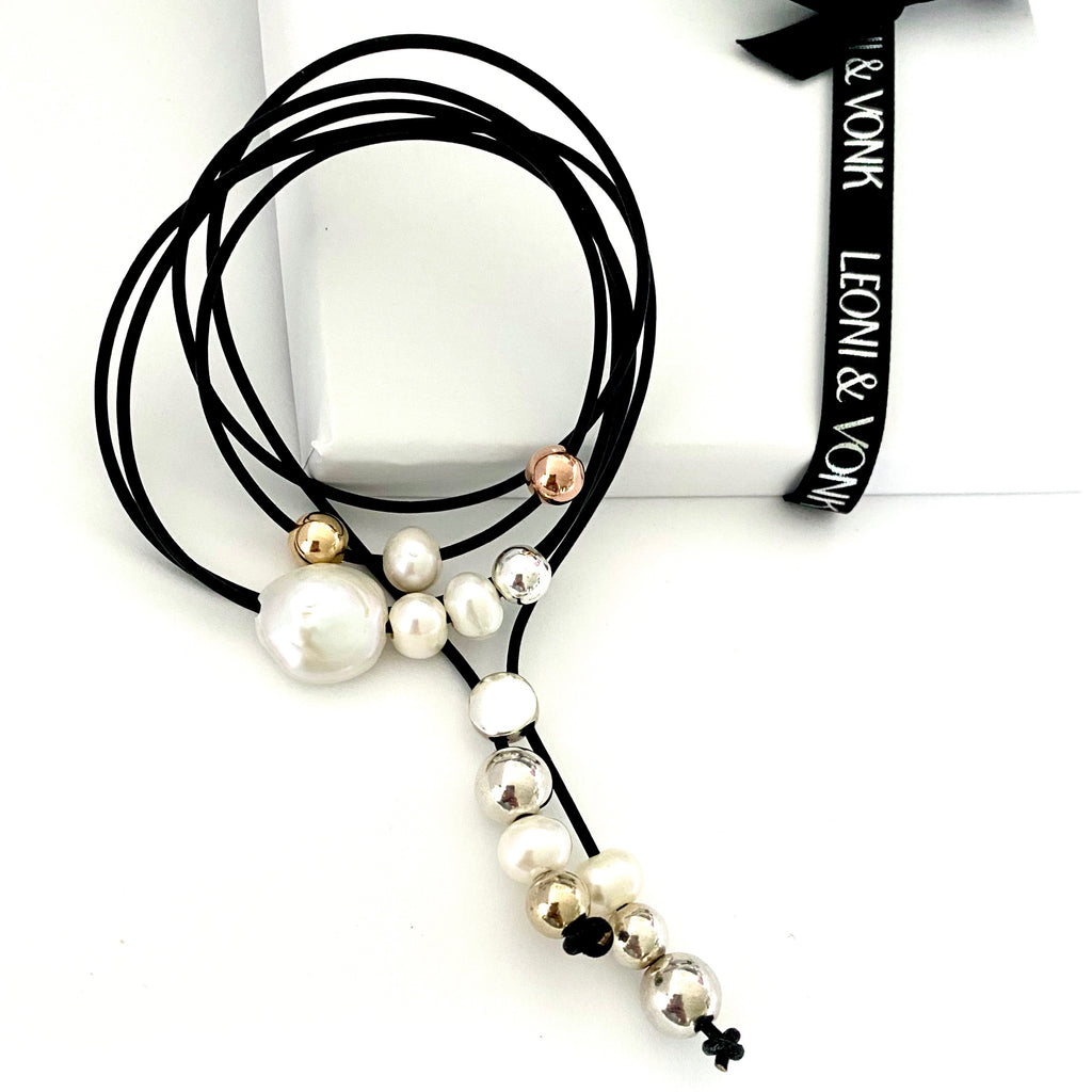 Leoni & Vonk black leather, sterling silver and gold fill beads necklace photographed near Leoni & Vonk ribbon