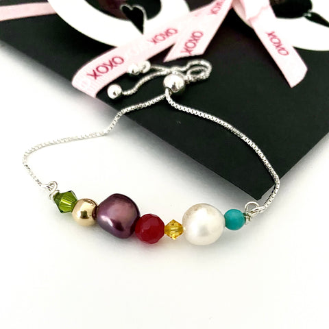 Leoni & Vonk colourful pearl and crystal sterling silver bracelet photographed with Mother's day packaging