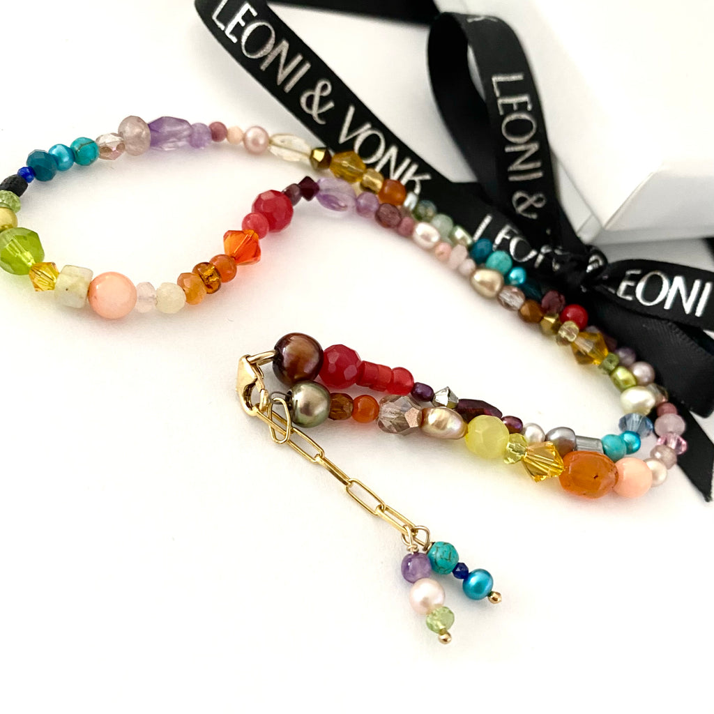 Leoni & Vonk multi-coloured semi-precious stone and pearl necklace photographed with Leoni & Vonk ribbon and box