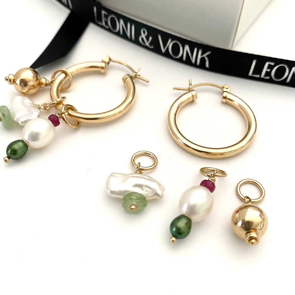 Leoni & Vonk gold fill hoop, pearl, kyanite, ruby earrings photographed with Leoni & Vonk ribbon and a white box