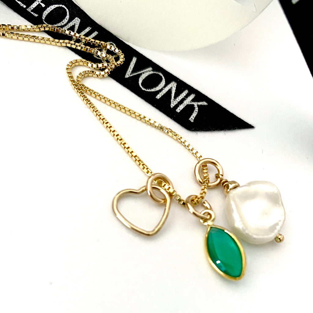 Leoni & Von heart, keshi pearl and green onyx drop gold necklace photographed near Leoni & Vonk ribbon