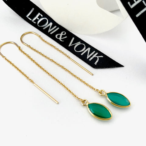 Leoni & Vonk green onyx and gold chain earrings photographed near Leoni & Vonk ribbon