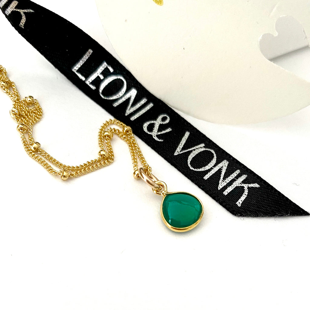 Leoni  Vonk green onyx gold drop necklace photographed with Leoni & vonk ribbon