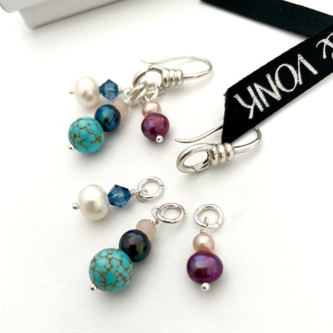 Leoni& Vonk sterling silver interchangeable earrings photogrpahed near Leoni & Vonk ribbon
