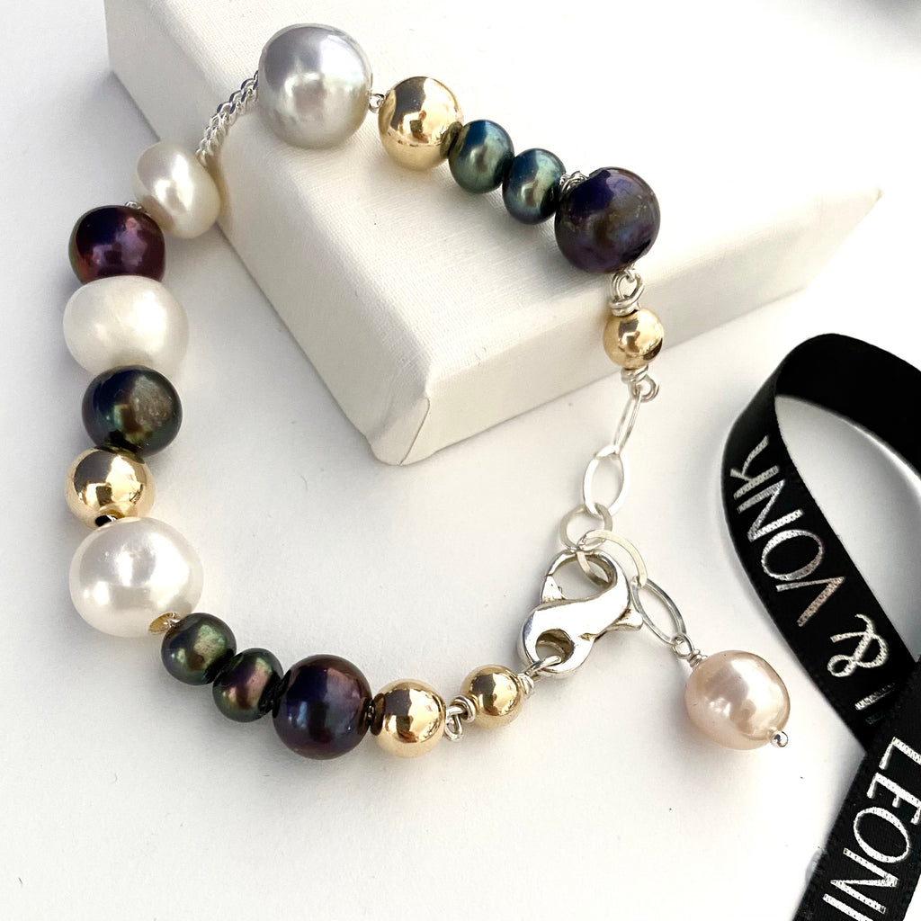 Leoni & Vonk pearl, gold and silver bracelet photographed near Leoni & Vonk ribbon