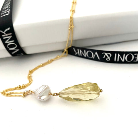 Leoni & Vonk citrine and keshi pearl gold necklace photogprahed near Leoni & Vonk ribbon