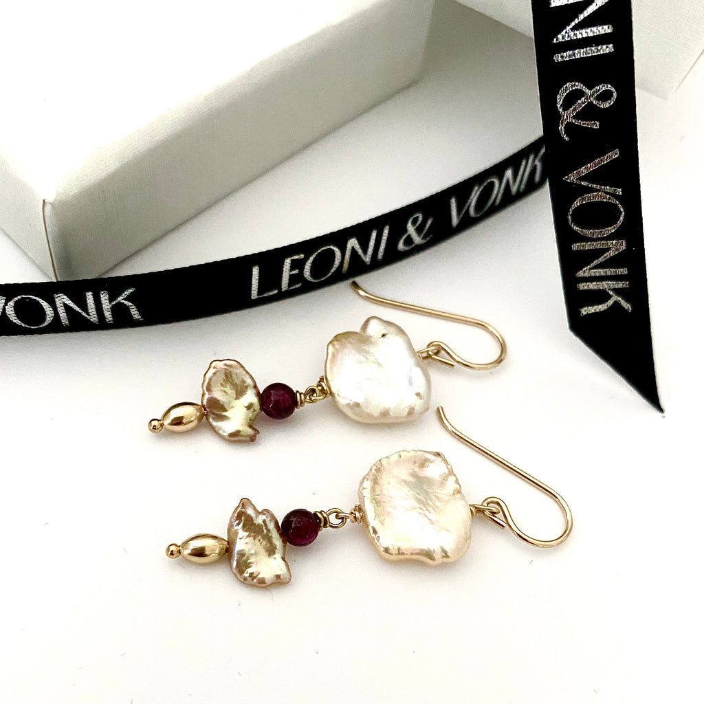 Leoni & Vonk keshi pearl and garnet gold earrings photographed near Leoni & Vonk ribbon and box