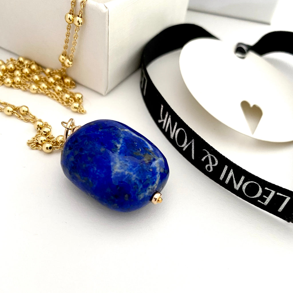 Leoni & Vonk lapis necklace on gold chain photographed near a white box