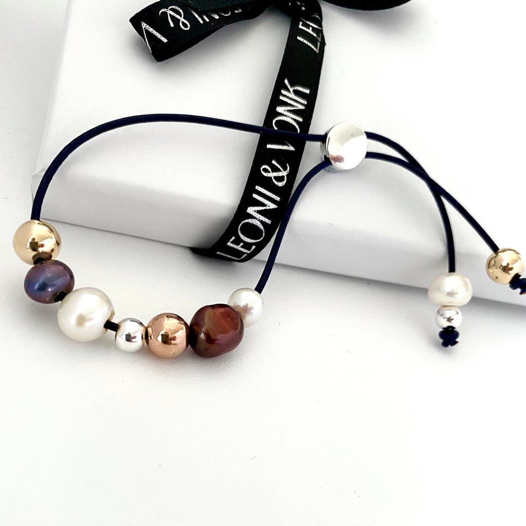 Leoni & Vonk pearl and midnight blue leather bracelet photographed near Leoni & Vonk ribbon