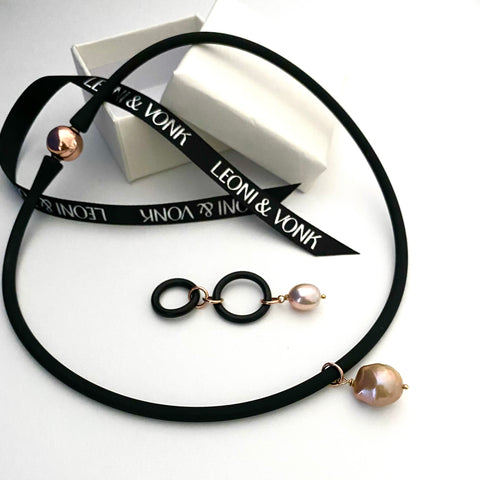 Leoni & Vonk neoprene adn pearl necklace photographed near Leoni & Vonk ribbon and box