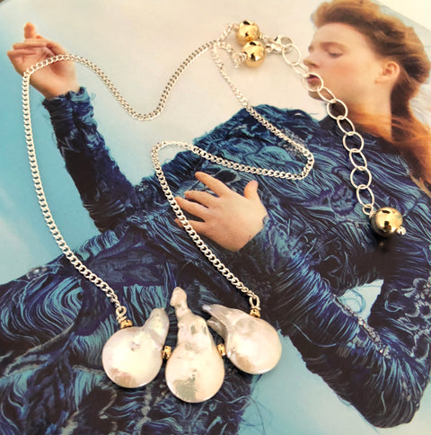 Leoni & Vonk white keshi pearl necklace photographed on a magazine page.