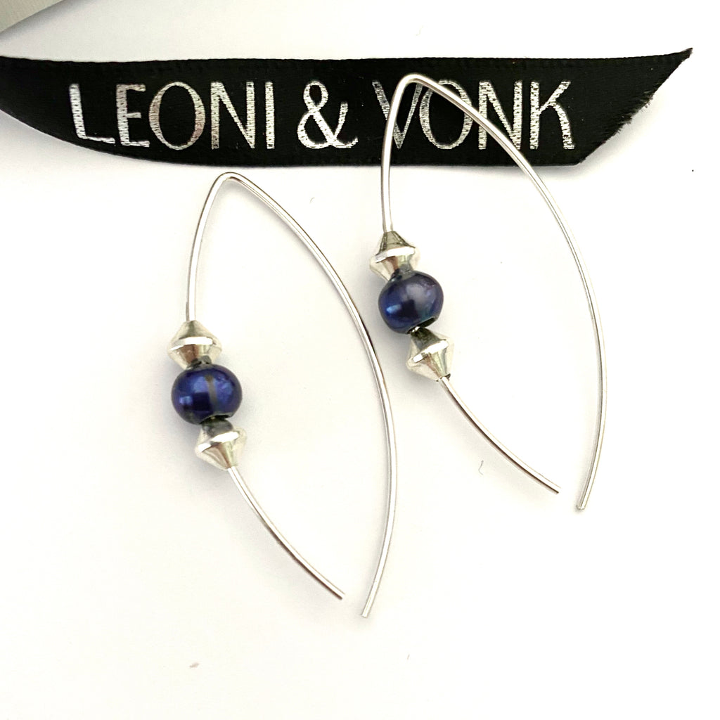 Leoni & Vonk sterling silver and peacock pearl earrings photographed near Leoni & Vonk ribbon
