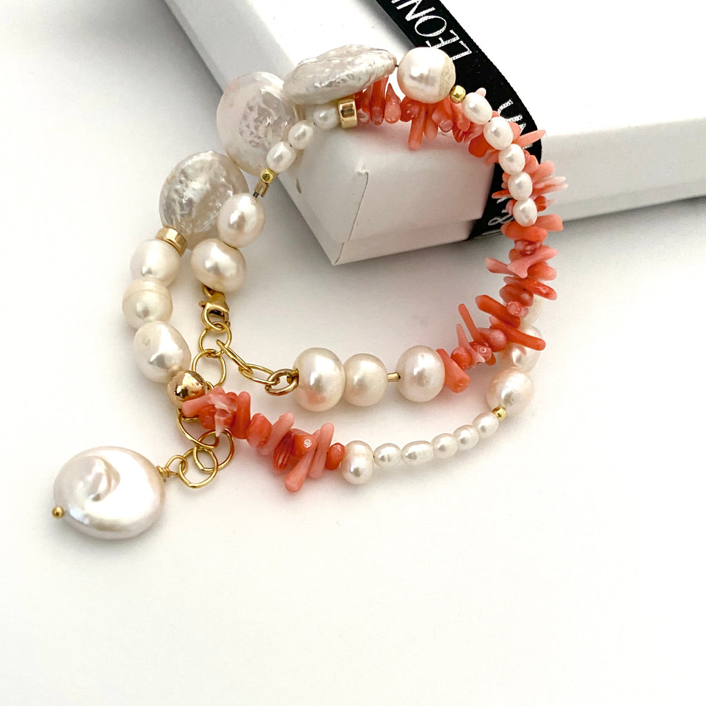 Leoni & Vonk pearl and coral bracelet photogrpahed near a Leoni & Vonk box and ribbon