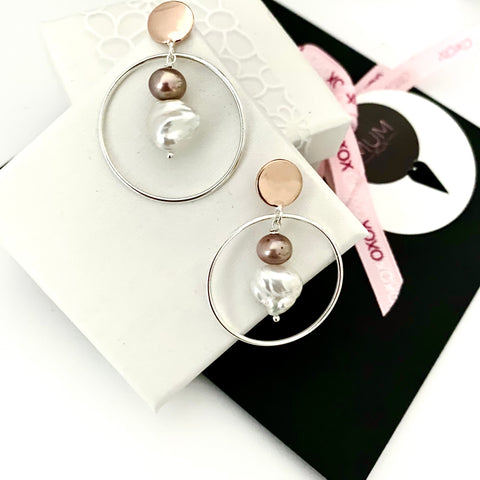 Leoni & Vonk rose gold, sterling silver circle and pearl earrings photographed with Mother's Day gift wrap