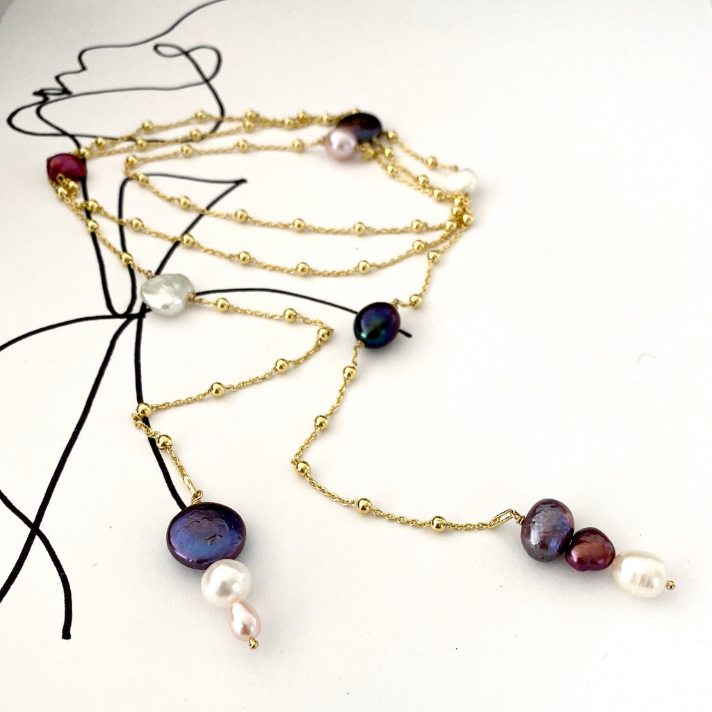 Leoni & Vonk gold and pearl long wrap necklace photographed on a white background with black line drawings.