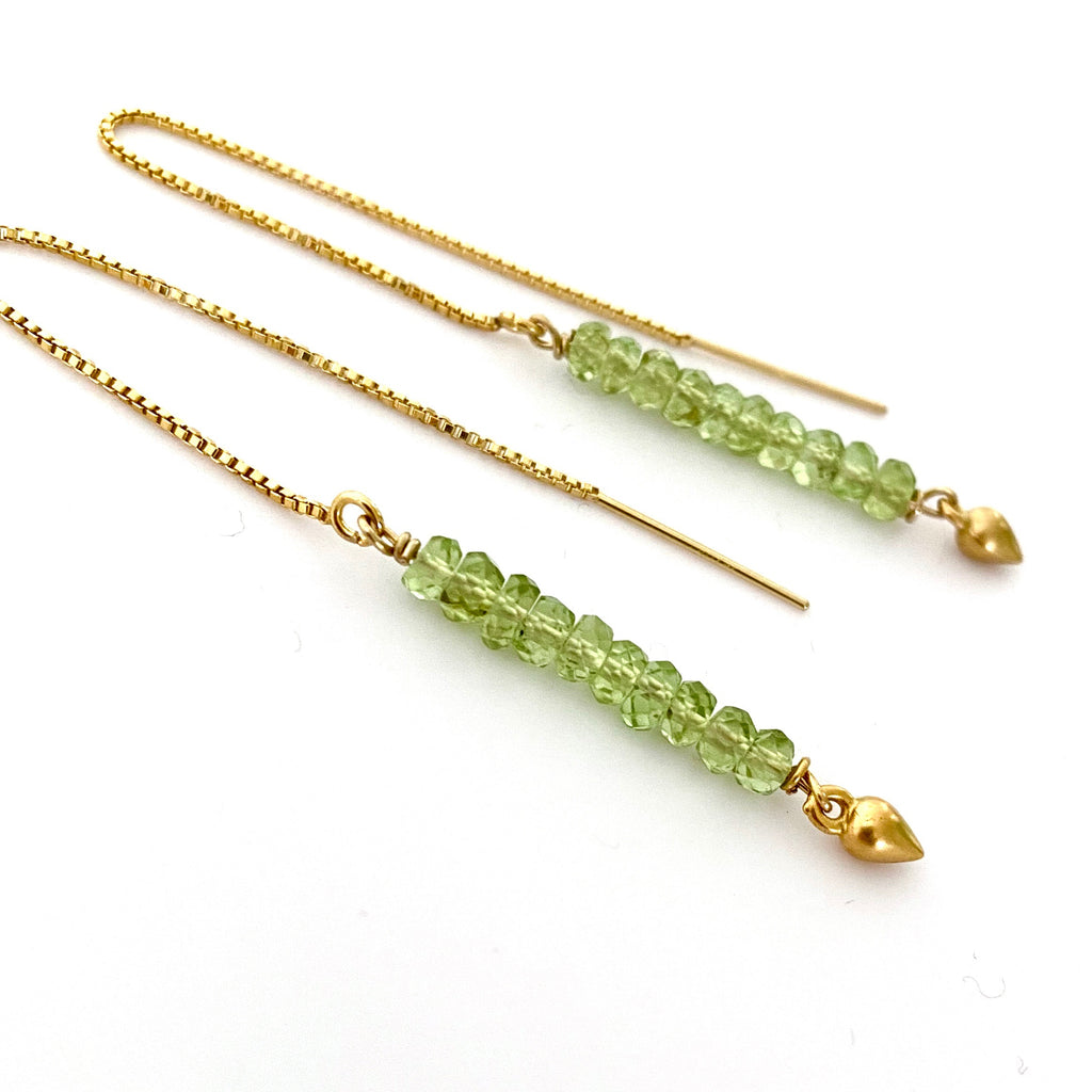 Leoni & Vonk peridot August birthstone and gold ear thread earrings on white background