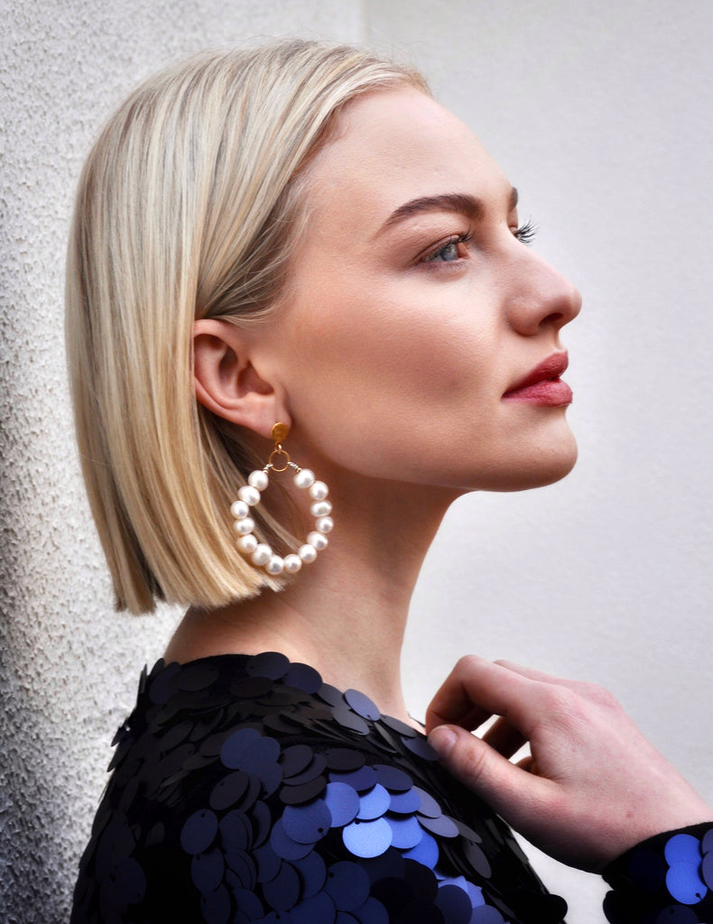 Model wearing Leoni & Vonk Phoebe pearl hoop earrings and blue Zara sequin dress