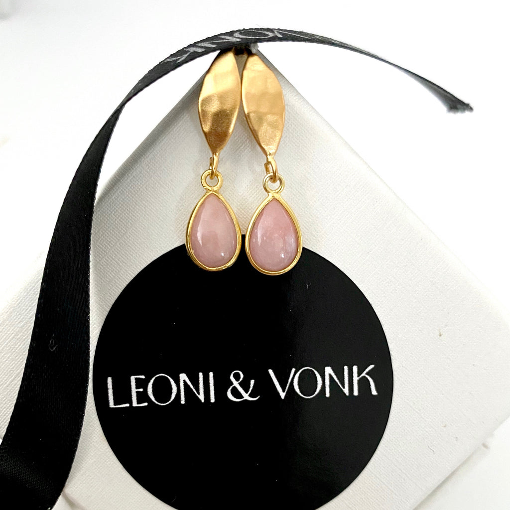 Leoni & Von pink opal and gold hook earrings photographed on a Leoni & Vonk box and ribbon
